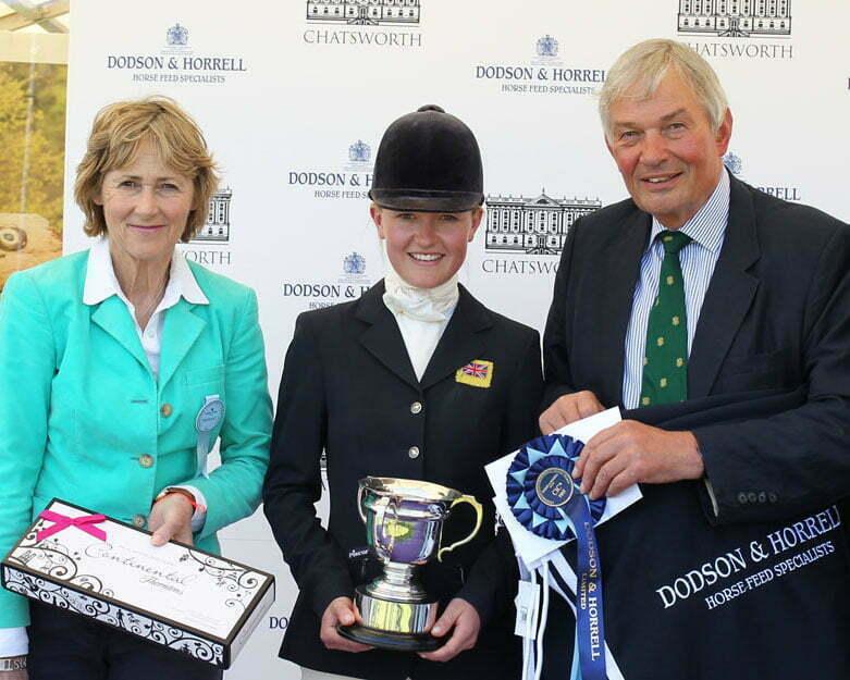 Eliza winning a trophy at Chatsworth